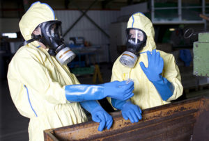 hazmat remediation workers in hazmat suits with breathers
